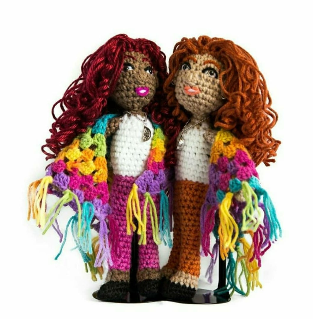 One bright pink and one orange crochet dolls