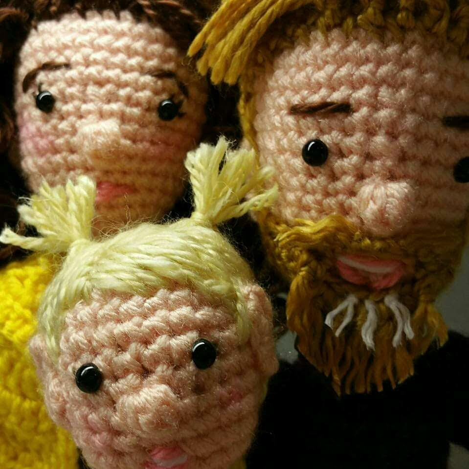 Closeup of crocheted Caucasian family dolls of man, woman and girl